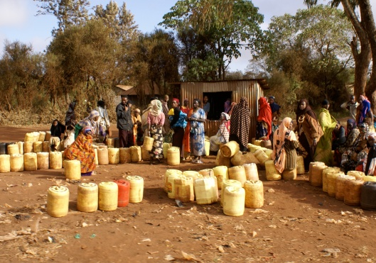 Women Lining Up For Water