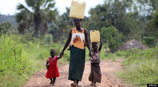 A mother and her children finish their day off by collecting dirty water in the Lira district of northern Uganda. Photo from Huffington Post.